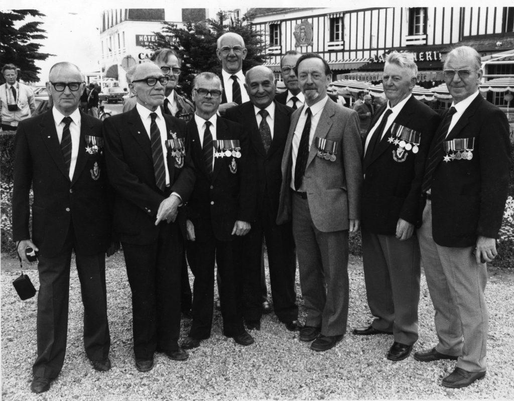 Juan Pujol in Normandy with war veterans